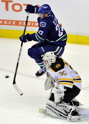 VANCOUVER, BC - JUNE 01:  Tim Thomas #30 of the Boston Bruins tends goal against Daniel Sedin #22 of the Vancouver Canucks during game one of the 2011 NHL Stanley Cup Finals at Rogers Arena on June 1, 2011 in Vancouver, Canada.  (Photo by Nick Didlick/Get