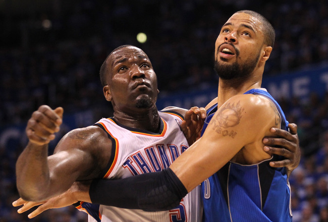OKLAHOMA CITY, OK - MAY 21:  Kendrick Perkins #5 of the Oklahoma City Thunder and Tyson Chandler #6 of the Dallas Mavericks battle for position in Game Three of the Western Conference Finals during the 2011 NBA Playoffs at Oklahoma City Arena on May 21, 2