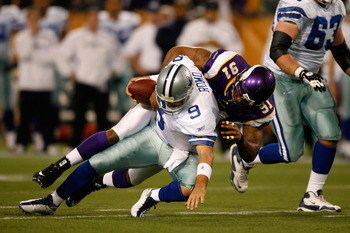 MINNEAPOLIS - JANUARY 17:  Quarterback Tony Romo #9 of the Dallas Cowboys is sacked by defensive end Ray Edwards #91 of the Minnesota Vikings in the first quarter during the NFC Divisional Playoff Game at Hubert H. Humphrey Metrodome on January 17, 2010 i
