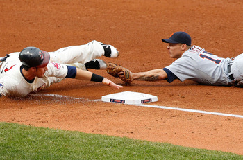 CLEVELAND - APRIL 30:  Matt LaPorta #7 of the Cleveland Indians is tagged out at third base by Brandon Inge #15 of the Detroit Tigers during the game on April 30, 2011 at Progressive Field in Cleveland, Ohio.  (Photo by Jared Wickerham/Getty Images)