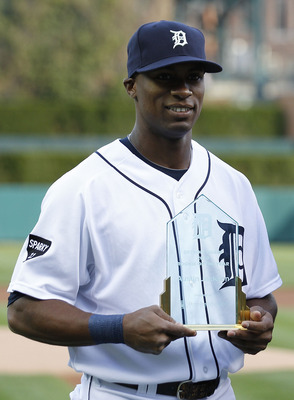 DETROIT - APRIL 26: Austin Jackson #14 of the Detroit Tigers receives the team's Rookie of The Year award prior to the start of the game against the Seattle Mariners at Comerica Park on April 26, 2011 in Detroit, Michigan. The Mariners defeated the Tigers