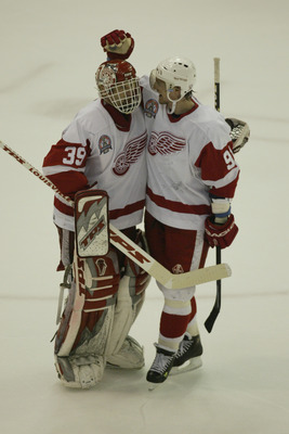 DETROIT, MI - JUNE 13:  Goaltender Dominik Hasek #39 of the Detroit Red Wings is congratulated by center Sergei Fedorov #91 during game five of the NHL Stanley Cup Finals against the Carolina Hurricanes on June 13, 2002 at the Joe Louis Arena in Detroit,