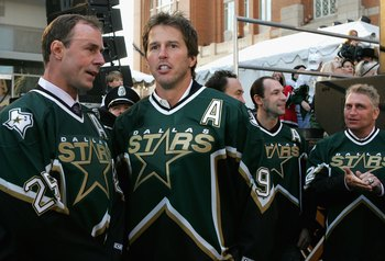 DALLAS - JANUARY 22:   Mike Modano #9 and Joe Nieuwendyk #25 of the 1999 Dallas Stars Stanley Cup team look on during the 1999 Dallas Stars Stanley Cup Reunion at the American Airlines Center on January 22, 2007 in Dallas, Texas.  (Photo by Bruce Bennett/