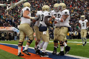 EL PASO, TX - DECEMBER 30:  Running back Cierre Wood #20 of the Notre Dame Fighting Irish celebrates a touchdown against the Miami Hurricanes during the Hyundai Sun Bowl at Sun Bowl on December 30, 2010 in El Paso, Texas.  (Photo by Ronald Martinez/Getty