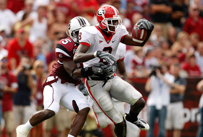 COLUMBIA, SC - SEPTEMBER 13:  A.J. Green #8 of the Georgia Bulldogs tries to break a tackle by Carlos Thomas #5 of the South Carolina Gamecocks during their game September 13, 2008 at Williams-Brice Stadium in Columbia, South Carolina.  (Photo by Streeter