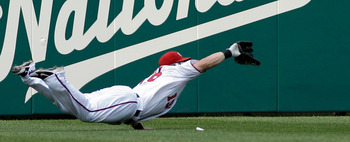 WASHINGTON, DC - JUNE 01: Left fielder Laynce Nix #19 of the Washington Nationals catches a ball hit by  Domonic Brown #9 of the Philadelphia Phillies (not pictured) for the third out of the sixth inning at Nationals Park on June 1, 2011 in Washington, DC