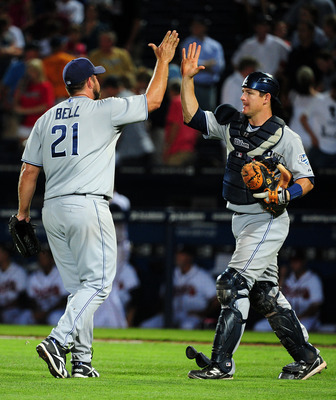 ATLANTA - MAY 31: Heath Bell #21 and Rob Johnson #32 of the San Diego Padres celebrate after the game against the Atlanta Braves at Turner Field on May 31, 2011 in Atlanta, Georgia. (Photo by Scott Cunningham/Getty Images)