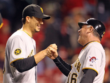 CINCINNATI, OH - MAY 18:  Charlie Morton #50 of the Pittsburgh Pirates is congratulated by Nick Leyva after pitching a 5 hit complete game shutout against the Cincinnati Reds at Great American Ball Park on May 18, 2011 in Cincinnati, Ohio.  The Pirates wo