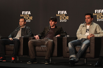 ZURICH, SWITZERLAND - JANUARY 10:  Lionel Messi (c) of Argentina alongside Xavi (r) and Andres Iniesta (l) of Spain during a press conference ahead of the FIFA Ballon d'or Gala at the Zurich Kongresshaus on January 10, 2011 in Zurich, Switzerland.  (Photo