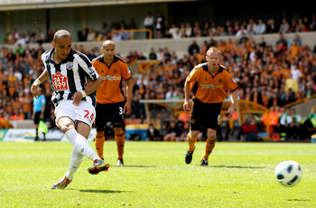 WOLVERHAMPTON, ENGLAND - MAY 08:  Peter Odemwingie of WBA scores their first goal from the penalty spot during the Barclays Premier League match between Wolverhampton Wanderers and West Bromwich Albion at Molineux on May 8, 2011 in Wolverhampton, England.