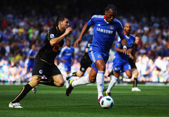 LONDON, ENGLAND - APRIL 09:  Didier Drogba of Chelsea evades Antolin Alcaraz of Wigan Athletic during the Barclays Premier League match between Chelsea and Wigan Athletic at Stamford Bridge on April 9, 2011 in London, England.  (Photo by Clive Rose/Getty