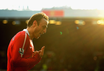 MANCHESTER, ENGLAND - MARCH 19: Dimatar Berbatov of Manchester United celebrates scoring the winning goal in the dying minutes during the Barclays Premier League match between Manchester United and Bolton Wanderers at Old Trafford on March 19, 2011 in Man