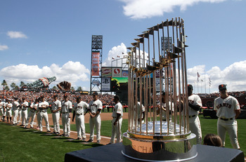 The Giants line up behind the Commisioner's Trophy during their home opener.