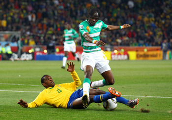 JOHANNESBURG, SOUTH AFRICA - JUNE 20:  Juan of Brazil tackles Gervinho of the Ivory Coast during the 2010 FIFA World Cup South Africa Group G match between Brazil and Ivory Coast at Soccer City Stadium on June 20, 2010 in Johannesburg, South Africa.  (Pho