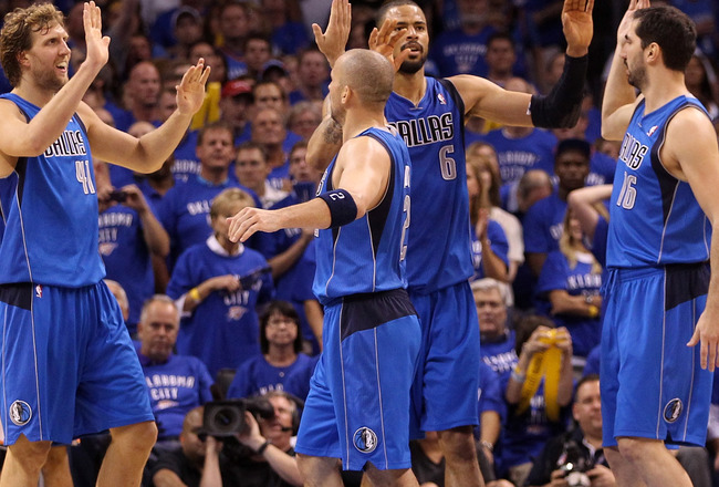 OKLAHOMA CITY, OK - MAY 23:  (L-R) Dirk Nowitzki #41, Jason Kidd #2, Tyson Chandler #6 and Peja Stojakovic #16 of the Dallas Mavericks react in the fourth quarter while taking on the Oklahoma City Thunder in Game Four of the Western Conference Finals duri