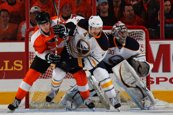 PHILADELPHIA, PA - APRIL 22:  Steve Montador #4 of the Buffalo Sabres and James van Riemsdyk #21 of the Philadelphia Flyers vie for position in Game Five of the Eastern Conference Quarterfinals during the 2011 NHL Stanley Cup Playoffs at Wells Fargo Cente