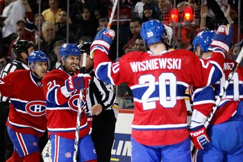 MONTREAL, CANADA - MARCH 8:  Members of the Montreal Canadiens celebrate a second period goal against the Boston Bruins during the NHL game at the Bell Centre on March 8, 2011 in Montreal, Quebec, Canada.  The Canadiens defeated the Bruins 4-1.  (Photo by