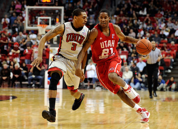 LAS VEGAS, NV - FEBRUARY 02:  Will Clyburn #21 of the Utah Utes drives against Anthony Marshall #3 of the UNLV Rebels during their game at the Thomas & Mack Center February 2, 2011 in Las Vegas, Nevada. UNLV won 67-54.  (Photo by Ethan Miller/Getty Images