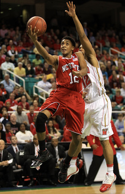 GREENSBORO, NC - MARCH 10:  Terrell Stoglin #12 of the Maryland Terrapins shoots against Ryan Harrow #12 of the North Carolina State Wolfpack during the second half of the game in the first round of the 2011 ACC men's basketball tournament at the Greensbo