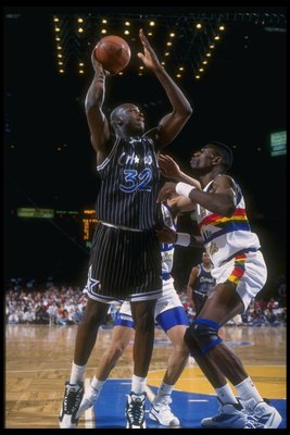 1992-1993:  Center Shaquille O''Neal of the Orlando Magic looks to shoot the ball during a game against the Denver Nuggets at McNichols Arena in Denver, Colorado. Mandatory Credit: Tim DeFrisco  /Allsport Mandatory Credit: Tim DeFrisco  /Allsport