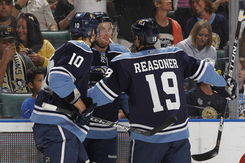 SUNRISE, FL - APRIL 2: Jack Skille #15 is congratulated by David Booth #10 and Marty Reasoner #19 of the Florida Panthers after scoring his first goal as a Panther against the Pittsburgh Penguins on April 2, 2011 at the BankAtlantic Center in Sunrise, Flo