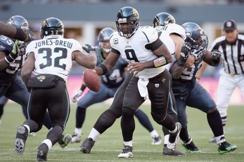 SEATTLE - OCTOBER 11:  Quarterback David Gerrard #9 of the Jacksonville Jaguars hands off the ball to Maurice Jones -Drew #32 during the game against the Seattle Seahawks on October 11, 2009 at Qwest Field in Seattle, Washington. The Seahawks defeated the