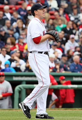 BOSTON, MA - MAY 05:  John Lackey #41 of the Boston Red Sox heads back to the mound after Erick Aybar and Torii Hunter of the Los Angeles Angels scored in the third inning on May 5, 2011 at Fenway Park in Boston, Massachusetts.  (Photo by Elsa/Getty Image