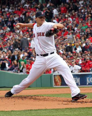 BOSTON, MA - APRIL 8:   John Lackey #42 of the Boston Red Sox throws against the New York Yankees in the first inning on Opening Day at Fenway Park on April 8, 2011 in Boston, Massachusetts. (Photo by Jim Rogash/Getty Images)