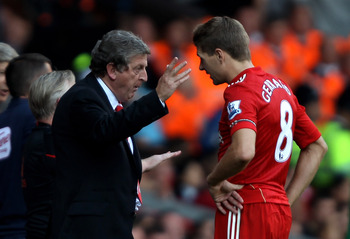 LIVERPOOL, ENGLAND - AUGUST 15:  Liverpool Manager Roy Hodgson issues instructions to Steven Gerrard during the Barclays Premier League match between Liverpool and Arsenal at Anfield on August 15, 2010 in Liverpool, England.  (Photo by Clive Brunskill/Get