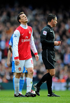 LONDON, ENGLAND - JANUARY 30:  Sebastien Squillaci #30 of Arsenal reacts after he is shown a straight red card by Referee Mark Clattenburg after his foul on Jack Hunt of Huddersfield during the FA Cup sponsored by E.ON fourth round match between Arsenal a