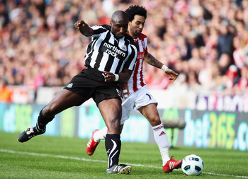 STOKE ON TRENT, ENGLAND - MARCH 19:  Jermaine Pennant of Stoke City battles with Sol Campbell of Newcastle United during the Barclays Premier League match between Stoke City and Newcastle United at Britannia Stadium on March 19, 2011 in Stoke on Trent, En