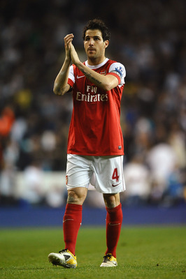 LONDON, ENGLAND - APRIL 20:  Cesc Fabregas of Arsenal applauds the fans during the Barclays Premier League match between Tottenham Hotspur and Arsenal at White Hart Lane on April 20, 2011 in London, England.  (Photo by Laurence Griffiths/Getty Images)