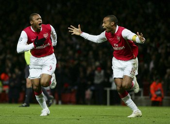 LONDON - NOVEMBER 21:  Julio Baptista of Arsenal celebrates with Thierry Henry of Arsenal (R) after Baptista scored during the UEFA Champions League Group G match between Arsenal and Hamburg SV at The Emirates Stadium on November 21, 2006 in London, Engla