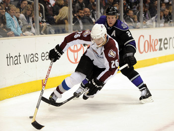 LOS ANGELES, CA - MARCH 22:  Paul Stasny #26 of the Colorado Avalanche is taken down by Matt Greene #2 of the Los Angeles Kings for a penalty during the first period on March 22, 2010 in Los Angeles, California.  (Photo by Harry How/Getty Images)