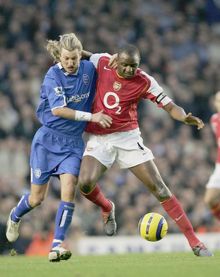 LONDON - DECEMBER 04:  Robbie Savage of Birmingham City and Partick Vieira of Arsenal battle for the ball during the Barclays Premiership match between Arsenal and Birmingham City at Highbury on December 4, 2004 in London, England.  (Photo by Phil Cole/Ge