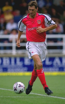 21 Jul 2001:  Tony Adams of Arsenal runs with the ball during the pre-season friendly match against Rushden & Diamonds played at Nene Park, in Irthlinborough, England. Arsenal won the match 2-0. \ Mandatory Credit: Shaun Botterill /Allsport