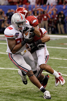NEW ORLEANS, LA - JANUARY 04:  Solomon Thomas #98 of the Ohio State Buckeyes intercepts a pass as he is tackled by Jarius Wright #4 of the Arkansas Razorbacks to seal the 31-26 victory for the Buckeyes against the Razorbacks in the Allstate Sugar Bowl at