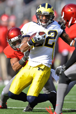 COLUMBUS, OH - NOVEMBER 27:  Darryl Stonum #22 of the Michigan Wolverines runs with the ball against the Ohio State Buckeyes at Ohio Stadium on November 27, 2010 in Columbus, Ohio.  (Photo by Jamie Sabau/Getty Images)
