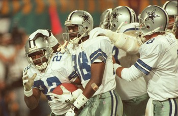 28 Jan 1996:  Running back Emmitt Smith #22 of the Dallas Cowboys is congratulated by teammates, including wide receiver Michael Irvin #88 and quarterback Troy Aikman #8, after scoring his second touchdown of the game in the fourth quarter of Super Bowl X