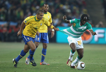 JOHANNESBURG, SOUTH AFRICA - JUNE 20: Felipe Melo of Brazil pulls at the shirt of Gervinho of Ivory Coast during the 2010 FIFA World Cup South Africa Group G match between Brazil and Ivory Coast at Soccer City Stadium on June 20, 2010 in Johannesburg, Sou