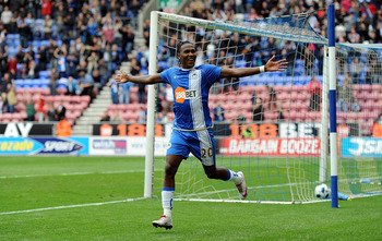 WIGAN, ENGLAND - OCTOBER 02: Hugo Rodallega of Wigan Athletic celebrates scoring his side's second goal during the Barclays Premier League match between Wigan Athletic and Wolverhampton Wanderers at DW Stadium on October 2, 2010 in Wigan, England.  (Photo