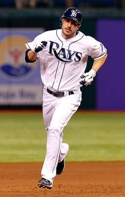 ST. PETERSBURG, FL - MAY 31:  Outfielder Matt Joyce #20 of the Tampa Bay Rays rounds the bases after his home run against the Texas Rangers during the game at Tropicana Field on May 31, 2011 in St. Petersburg, Florida.  (Photo by J. Meric/Getty Images)