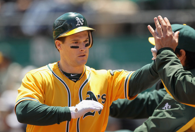 OAKLAND, CA - JUNE 01:  Josh Willingham #16 of the Oakland Athletics is congratulated by teammates after he hit a two run home run in the first inning against the New York Yankees at Oakland-Alameda County Coliseum on June 1, 2011 in Oakland, California.
