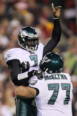 LANDOVER, MD - NOVEMBER 15:  Michael Vick #7 of the Philadelphia Eagles celebrates with team mate Mike McGlynn #77 after throwing his teams first touchdown against the Washington Redskins on November 15, 2010 at FedExField in Landover, Maryland.  (Photo b