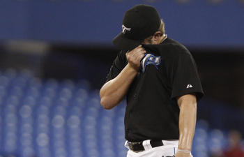 TORONTO, ON - SEPTEMBER 28: Kyle Drabek #4 of the Toronto Blue Jays regroups after a run scores against the New York Yankees during an MLB game at the Rogers Centre September 28, 2010 in Toronto, Ontario, Canada. (Photo by Abelimages/Getty Images)
