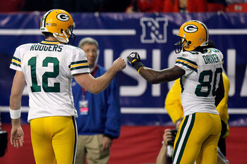 ATLANTA, GA - JANUARY 15:  (L-R) Aaron Rodgers #12 and Donald Driver #80 of the Green Bay Packers celebrate a play against the Atlanta Falcons during their 2011 NFC divisional playoff game at Georgia Dome on January 15, 2011 in Atlanta, Georgia.  (Photo b