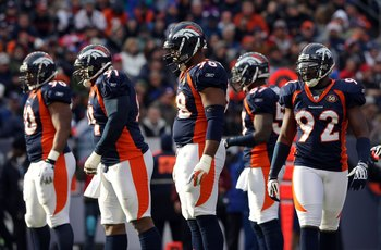 DENVER - JANUARY 03:  (L-R) Kenny Peterson #90, Ronald Fields #91, Ryan McBean #98 and Elvis Dumervil #92 of the Denver Broncos defense prepare for action against the Kansas City Chiefs during NFL action at Invesco Field at Mile High on January 3, 2010 in