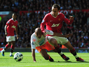 MANCHESTER, ENGLAND - MAY 22:  Dimitar Berbatov of Manchester United battles withAlex John-Baptiste of Blackpool during the Barclays Premier League match between Manchester United and Blackpool at Old Trafford on May 22, 2011 in Manchester, England.  (Pho