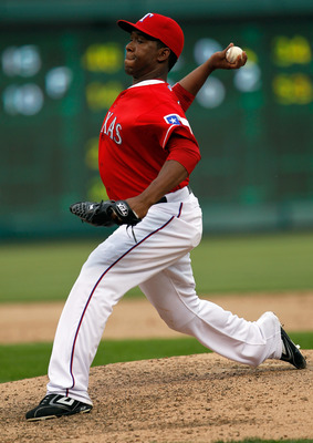 ARLINGTON, TX - APRIL 01:  Closing pitcher Neftali Feliz #30 of the Texas Rangers pitches in the top of the ninth inning against the Boston Red Sox on Opening Day at Rangers Ballpark in Arlington on April 1, 2011 in Arlington, Texas.  (Photo by Tom Pennin
