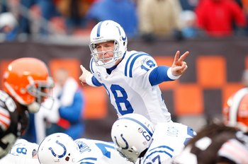 CLEVELAND - NOVEMBER 30:  Quarterback Peyton Manning #18 of the Indianapolis Colts signals a play at the line of scrimmage behind center during their NFL game against the Cleveland Browns on November 30, 2008 at Cleveland Browns Stadium in Cleveland, Ohio
